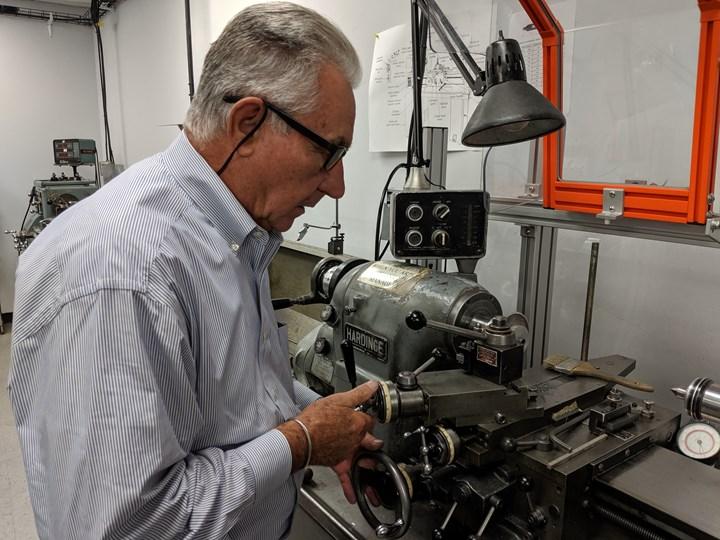 man working on custom machine